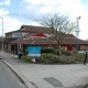 Markfield Community Centre can be seen from a sideways perspective, the road to the left of the Centre can be seen