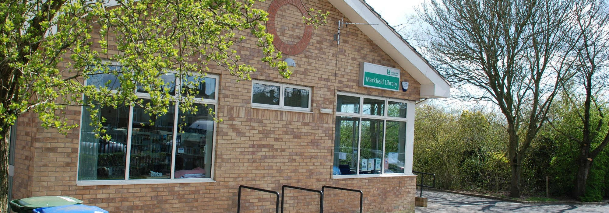 Markfield Library, side of the building can be seen, bike racks also can be seen up against the library wall